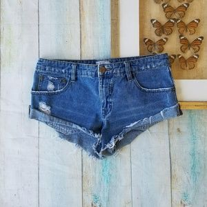 Free People Distressed Cheeky Cutoff Mini Shorts